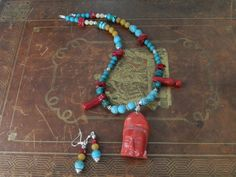Turquoise and Red Coral BUDDHA necklace and by chrissyslove4beads