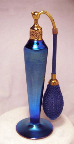 DeVilbiss Perfume Bottle for Steuben Blue Aurene. Devilbiss made the hardware & Steuben made the bottle. Love,Love,LOVE this color!! Circa 1925-27.