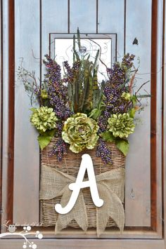A Front Door Welcome, I chose a flat basket as alternative to a wreath for my front door! Front Door Wreath