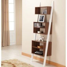 This leaning bookcase and display shelf will bring modern style and functionality to your home or office space. Made of wood and MDF, this shelf is finished with white and walnut and features five leveled pocket shelves for trendy storage. Ladder Bookcase, Bookshelves, Leaning Bookshelf, Leaning Shelf, Regal Display, Contemporary Bookcase, Modern Bookcase, Computer Armoire, Cool Coffee Tables