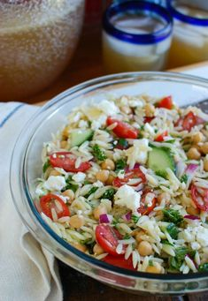Summer Orzo Pasta Salad is a healthy pasta salad packed with lots of vegetables, chickpeas and feta cheese topped with a light red wine vinaigrette. // acedarspoon.com #orzo #salad