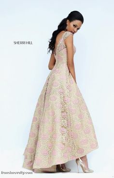 Sherri Hill 50612 is a 1950's inspired tea length dress with a boat neckline.