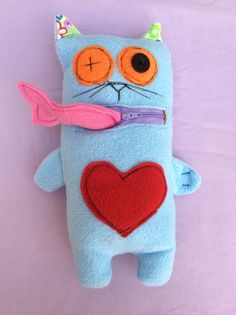 Cat with a fish doll Available now on store. Worldwide shipping. Contact me for more details at https://www.facebook.com/HappyLiron