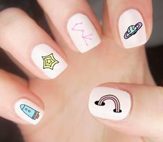 Space Doodles are the best doodles.  Get this super cute set today!  #diynails #manicure #naildecals #spacenails