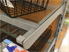 Most Glass Shelf is just that, all glass. This lengthy run includes metal channels underneath as braces and supports. But the metal channels clip onto special mounts inside the Gondola Arms. Are th... Glass Shelves, Braces, Shelf, Arms, Stairs, Label, Retail, Color, Home Decor