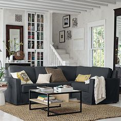 LOVE the jute rug with the charcoal sectional (I want to do thisssssssss). Also love the white mullions and stairs but that doesn't really work in our condo
