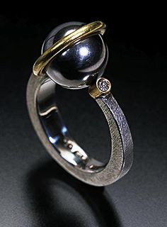 Andy Cooperman - Orbit Ring. 18K Gold, Sterling Silver & Stainless Steel Ball Bearing with Diamond. Seattle, Washington. Circa Early-21st Century.