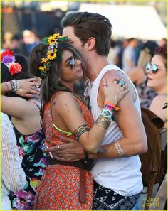 Sarah Hyland & Dominic Sherwood Get Cozy at Coachella 2015