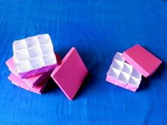 This is how to make a compartment box out of just two papers and some tape or glue. The box-paper is pink on one side, white on the other side. And the lid p...
