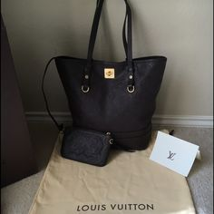 L.V. Citadine PM. Monogram Empreinte Leather. Louis Vuitton bag! Gently used, beautiful leather, a little rubbing and wear at the bottom corners (see pictures). Original receipt, Louis Vuitton box, and dust bag. If you want more pictures just let me know.! Louis Vuitton Bags Shoulder Bags