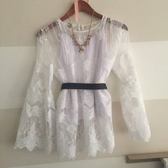 Boho lace bell sleeve top Beautiful lace detailing. Size says Large but fits more like a small so marked accordingly. Received as a gift but lace is stiffer than I would like. Comes with inner tank. Belt in first pic is for reference only. Tops Blouses