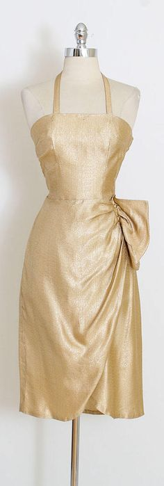 ➳ vintage 1950s dress * beautiful gold lurex dress * halter straps tie behind neck * side gathers details * metal side zipper  condition   good - the lining has been removed and there are a few tiny rust spots, one near center front neckline and another at center front waist. presents beautifully. fits like s/m  length 46 bodice 17 bust 36 waist 30 hips 40  ➳ shop http://www.etsy.com/shop/millstreetvintage?ref=si_shop  ➳ shop policies http://www.etsy.c...