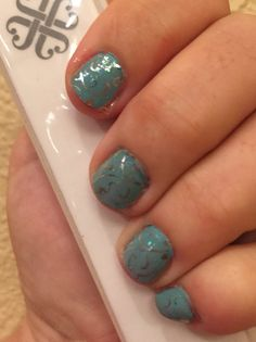 Loving the layered look!  Silver Floral over Glitter Effect top coat over exclusive Morning Mist. #layeredlook #springtime #morningmist #robinseggblue #scrollwork #glittertopcoat #nailart #nailsmadeeasy #jamberry #nailswraps #manicure