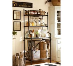 """Pretty storage here...""""10 Clever Ways to Use Baskets""""  (I don't think I could have a sign advertising """"hot buttered popcorn"""" and not want to eat that all the time...! ha)"""