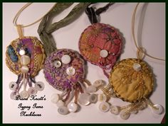 """Diane Knott's """"Gypsy Gem"""" necklace pendants - textiles, vintage mother-of-pearl buttons and seed beads embellished with hand embroidery and specialty threads"""