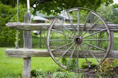 An old wagon wheel displayed as a garden decoration Stock Photo - 9753047