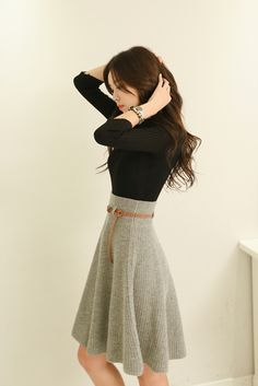 I love everything about this. The fabric and color of the skirt, paired with a simple black top.