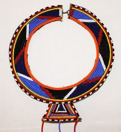 Africa | Beaded collar from the Masai women of Kenya | It is a wedding necklace, traditionally worn during special ceremonies and festivals. It is created from seed beads carefully woven onto a leather backing and fastened with a simple wire hook.  Long strands swing from the main collar with cowrie shells to bring prosperity. | 35.99$