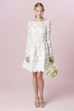 Short lace wedding dress with long sleeves and a bateau neck