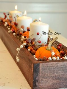 Cushion candles, pumpkins, and berry garlands with Spanish moss to fashion a simple, beautiful centerpiece.