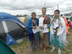 Mom, me and my daughter in Traditional dress and Jingle dress ragalia the year I came back to the Pow wow circle.