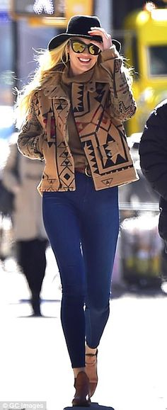 Showing what she's got: The 28-year-old Victoria's Secret model had pulled herself into a pair of dark jeans that looked painted onto her chiseled legs