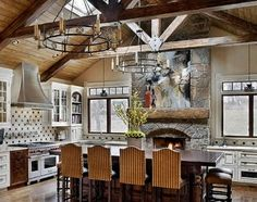 Classic Chic Home: Add Warmth and Character with a Kitchen Fireplace Love the exposed beams and windowa
