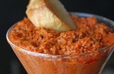 Romesco Dip  1/4 cup sliced or slivered almonds, or half almonds and half pine nuts  1 garlic clove, peeled  2 thick slices French bread, toasted (or 3 if you're using a baguette)  2 red peppers, roasted  1-2 Tbsp. red wine, sherry or balsamic vinegar  1 tsp. paprika