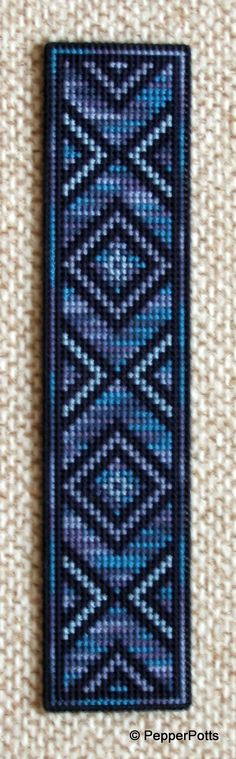 One of my more indulgent designs, because whilst the 14ct plastic canvas was a scrap, not all of the threads were. I bought the variegated stranded cotton specially to do this bookmark, because I loved the colour combination so much. I worked the plain lines first, then 'painted in' the Anchor variegated thread.
