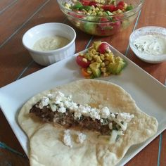 Lamb/beef gyros with roasted corn salad, hummus and tzatziki