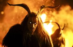 A man dressed in a traditional Perchten costume and mask performs during a Perchten festival in the western Austrian village of Kappl on November 13, 2015. Each year in November and January, people in the western Austria regions dress up in Perchten (also known in some regions as Krampus or Tuifl) costumes and parade through the streets to perform a 1,500-year-old pagan ritual to disperse the ghosts of winter.