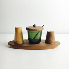 { d e s c r i p t i o n } Vintage Teak and glass cruet set designed by Kaj Franck Manufacturer: Nuutajärvi (Glass part), Luhti Oy (Teak parts) Production years: Size: Teak plates depth cm (About inch), Teak plate diameter: 20 cm x cm ( About inch x Contemporary Interior, Dark Colors, Set Design, Glass Jars, Old And New, Finland, Floating Shelves, Teak, Modern