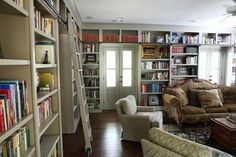 Library with rolling ladder - traditional - living room - atlanta - T-Olive Properties