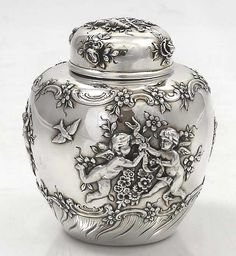 Tiffany sterling tea caddy with putti. www.teacampaign.ca  Source: see below.