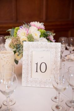 Wedding reception details, table number in white frame with small pink and white rose centerpiece. Summer Wedding at Turner Hills - BKB & CO. | Boston Wedding Photography and Video Studio