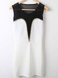 Black top of shirt is mesh there is gold studs and the bottom is white