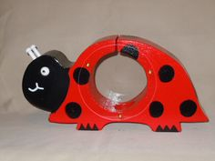 Adorable red lady bug piggy bank. It takes money thru the slot on top and it has a plug in the bottom to take it out. Non toxic paints are used. All handmade with love. The lady bug comes in various colors also, Yellow, hot pink, pink,orange. Check out our Etsy shop under andersonwoodworks.
