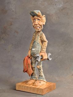"Wood carving ""mechanic"" by Dwayne Gosnell"