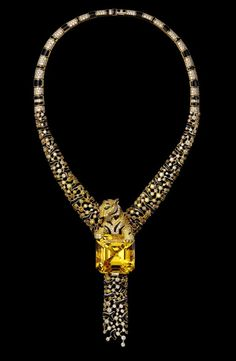 The Emblematic Panther – High Jewelry Necklace Yellow gold, one 86.85 carat emerald-cut yellow beryl, yellow diamonds, brown diamonds, emera...