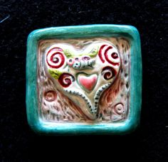 Small Heart and Bird Tile.Marcia Hovland, Royal Oak, MI.  Her beautiful work is always available at the Royal Oak Nature Society Fundraiser every April.  She also designed the exclusive tiles we present to award winners every year.