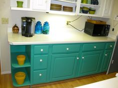 A budget-friendly kitchen makeover for a dated oak kitchen including bright turquoise kitchen cabinets, DIY solid maple wood counters, ...