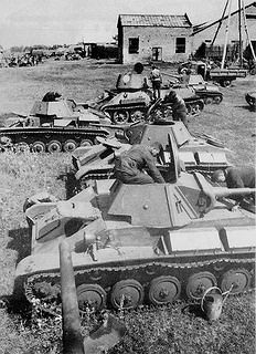 Russian T70 light tanks conducting replenishment and maintenance during the Kursk campaign, July 1943.