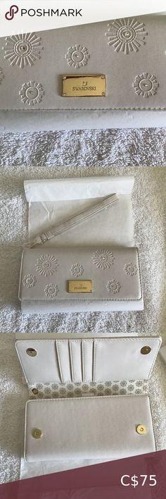 Check out this listing I just found on Poshmark: NWOT Swarovski wallet. #shopmycloset #poshmark #shopping #style #pinitforlater #Swarovski #Handbags
