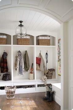 white mud room with beadboard