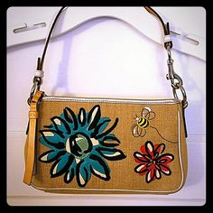 Authenic Coach purse Coach purse with pretty embroidery designs! Colorful flowers and 2 bumble bees, 1 on the front and 1 on the back. Used a handful of times but in great condition! 9 inches across and 5 inches vertically. Coach Bags Shoulder Bags