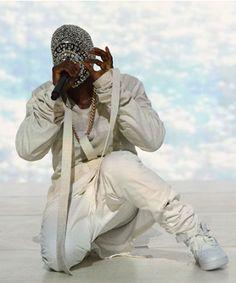 Kanye West jeweled mask at the Paris Fashion week