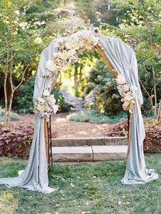 Draped floral ceremony arch