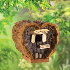 Heart-shaped honeymoon suite is a wonderful little love nest  for any lucky couple! Rough wood construction and real moss trim add the  look of a lovingly fashioned handicraft. Hole  7/8quot diameter. Loop for  hanging.    Weight 0.5 lb. Wood. 5 1/8quot x 3 1/2quot x 4 3/4quot high.