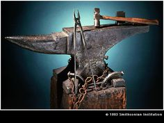 A 19th-Century anvil and blacksmith's tools.
