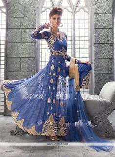 Be your own style icon with blue net designer suit. The embroidered and patch border work on attire personifies the entire appearance. Comes with matching bottom and dupatta. (Slight variation in colo...